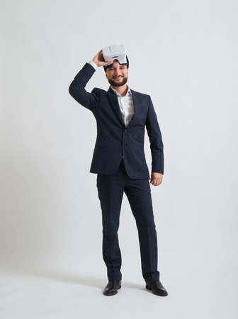 formal wear: Businessman in a formal wear likes the 3d effect made by virtual reality glasses
