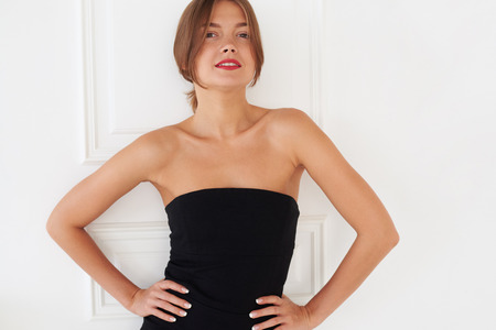 ladylike: A natural beauty of a pretty European woman. Brown eyes, blonde hair, ivory skin and black dress – that is all that you need to have a beautiful photo