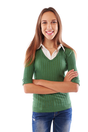 Mid portrait of young Caucasian girl folding arms while posing at the camera over white background Stock Photo