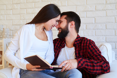 rubbing noses: Close-up of loving couple. Rubbing noses as a sign of love and about to kiss each other. Smiling at each other. The concept of togetherness