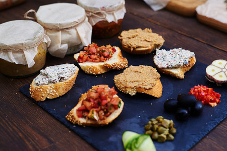 Top view of a set of appetizer canapes of baguette with different combinations of toppings. Crostini with different toppings