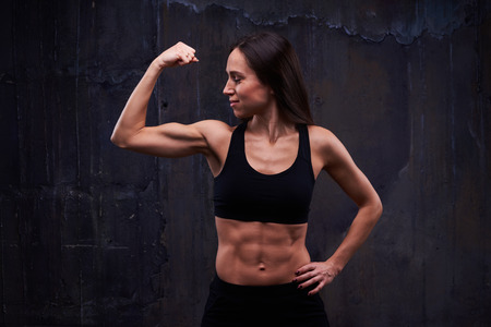 Close-up of slim athletic female performing effective bicep workout Stock Photo