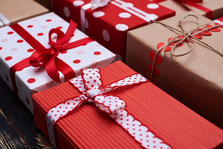 Side view of present boxes tightly arranged to each other. Polka dot wrapped presents placed on the flat layout