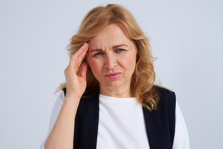 Mature blond with migraine
