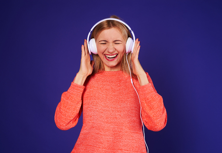 funny blond in headphones