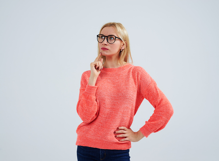 thoughtful young blond in glasses