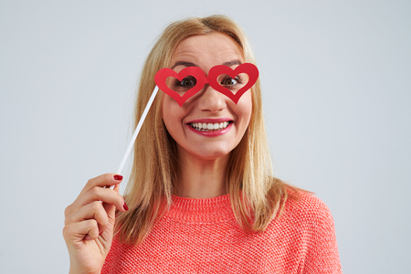 young blond in paperheart shaped glasses