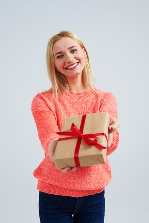 young blond smiling and holding gift