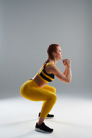 strong rude woman doing squats
