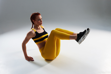 rude woman training core muscles