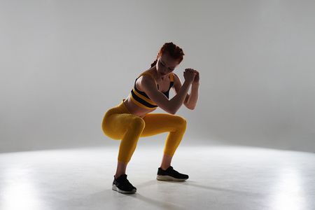 woman in sportswear doing squats