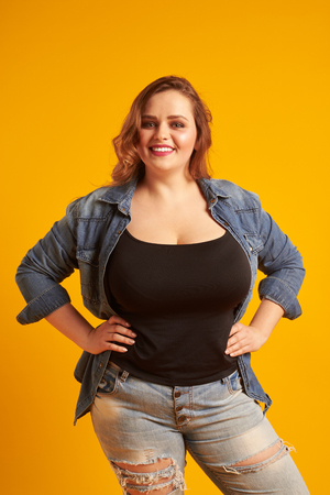 Beautiful plus-size model with big breast smiling at camera Zdjęcie Seryjne