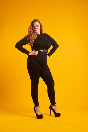 Gorgeous plus-size model posing at camera