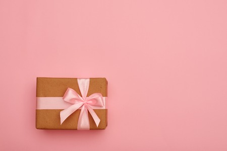 Present box with pink bow