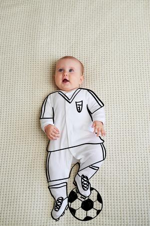 Cute baby girl sketched as footballer Zdjęcie Seryjne - 105345478