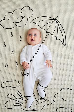 Adorable baby girl sketched as holding umbrella Reklamní fotografie