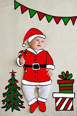 Little baby girl sketched like Santa Zdjęcie Seryjne