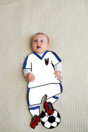 Baby dressed up as football player Reklamní fotografie
