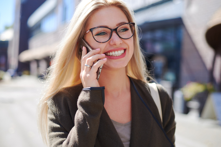 Happy woman talking on mobile phone in city Zdjęcie Seryjne - 116505463