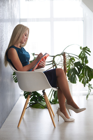 Beautiful businesswoman writing on book in office Reklamní fotografie