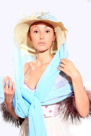 The girl in a straw hat and a blue cape Stock Photo - 4156157