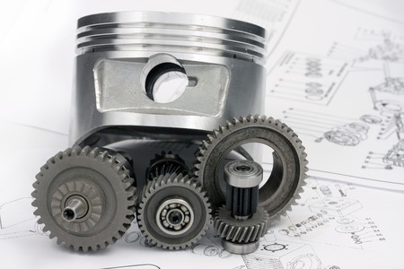 The reducer, key, the piston, head and other details lie on the drawing.