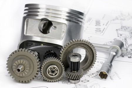 machine part: Reducer, the key, a head and other details lie on the drawing. Stock Photo