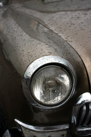 Headlight of the old car in the rain Stock Photo - 4266230