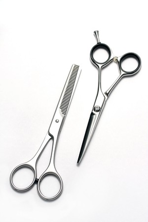 hairdress: Professional hairdressers scissors, usual and for giving of final form hairdress, they lay on white table