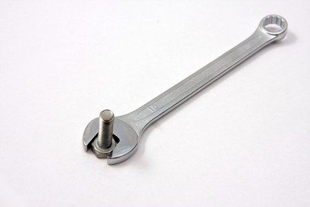 clamped: In wrench jaws bolt is clamped Stock Photo