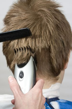 Hairstyle machine, kind in the rear Stock Photo - 4482543