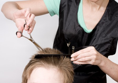 Hairdresser cuts client with scissors Stock Photo - 4528016