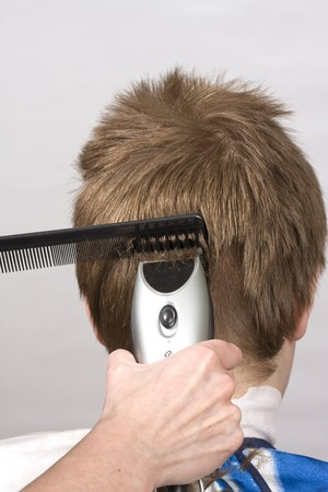 Hairstyle machine, kind in the rear Stock Photo - 4528023