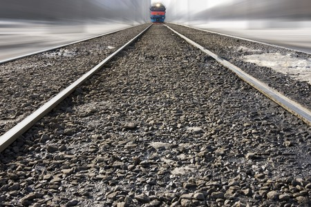 Train approaches on impossible rails photo