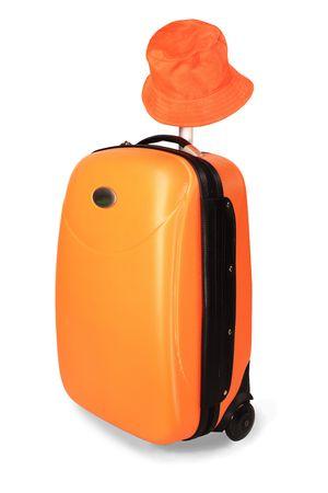 lugage: Orange travel case and sun hat from sun