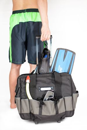 lugage: Travel case with accessories for Snokerling and man on background scene out of focus Stock Photo