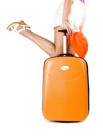 lugage: woman runs with a suitcase for travel