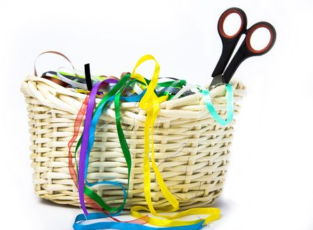 basket embroidery: Color silk ribbons for embroidery and a Scissors lie in a wattled basket from rods  Stock Photo