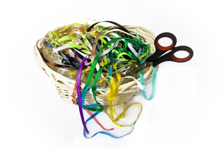 basket embroidery:  Color silk ribbons for embroidery and a Scissors lie in a wattled basket from rods
