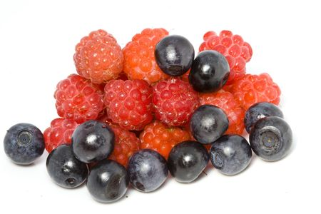 Berries of a fresh raspberry and bilberry close up on a white background photo