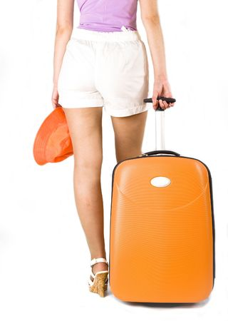 woman with suitcase for travels, focus on suitcase