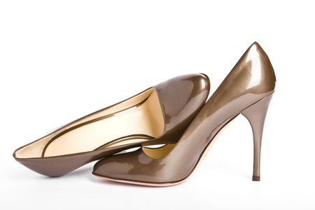 Beige-golden female new varnished shoes on high heel-stiletto photo