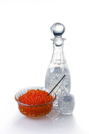 Crystal Decanter with vodka and capacity with red caviar photo