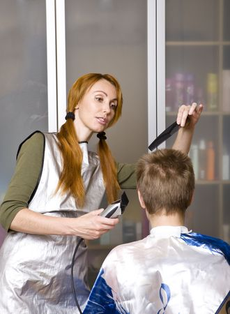 Pretty woman hairdresser cuts client Stock Photo - 6466434
