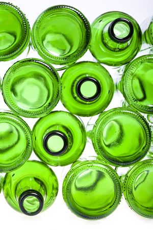 Bottoms of empty glass bottles on white background photo