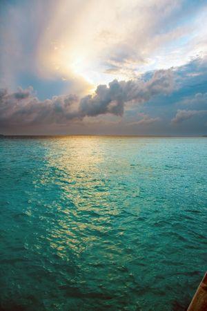 Maldives. Solar rising above ocean photo