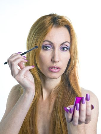 Portrait of the young woman with a make-up in pink tones and with long nails Stock Photo - 6825943