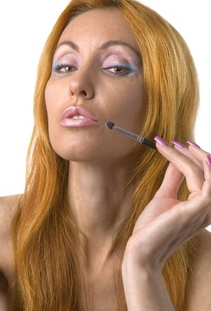 Portrait of the young woman with a make-up in pink tones and with long nails photo