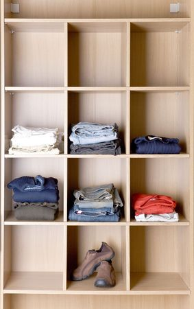 accurately: Clothes in wardrobe on the shelves Stock Photo
