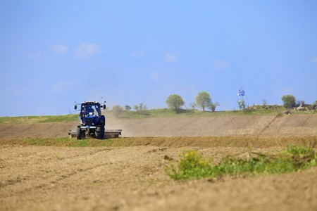 Tractor works in the field photo